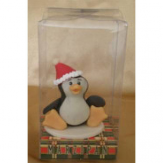 Sitting penguin in Santa Claus' hat